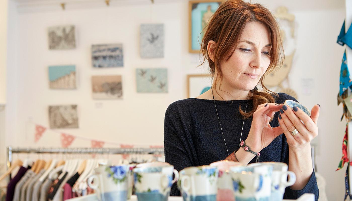 Woman looking at tea cup