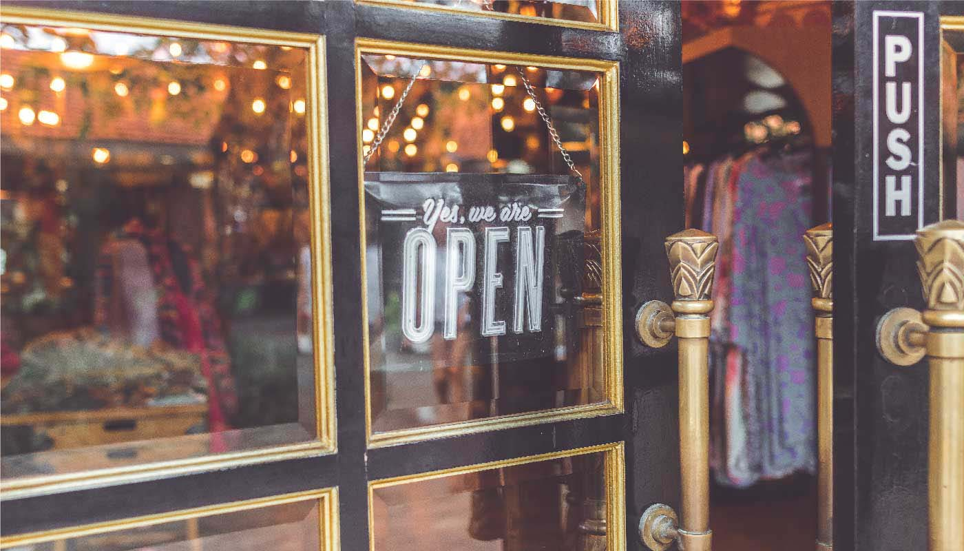 Open sign hanging in boutique window