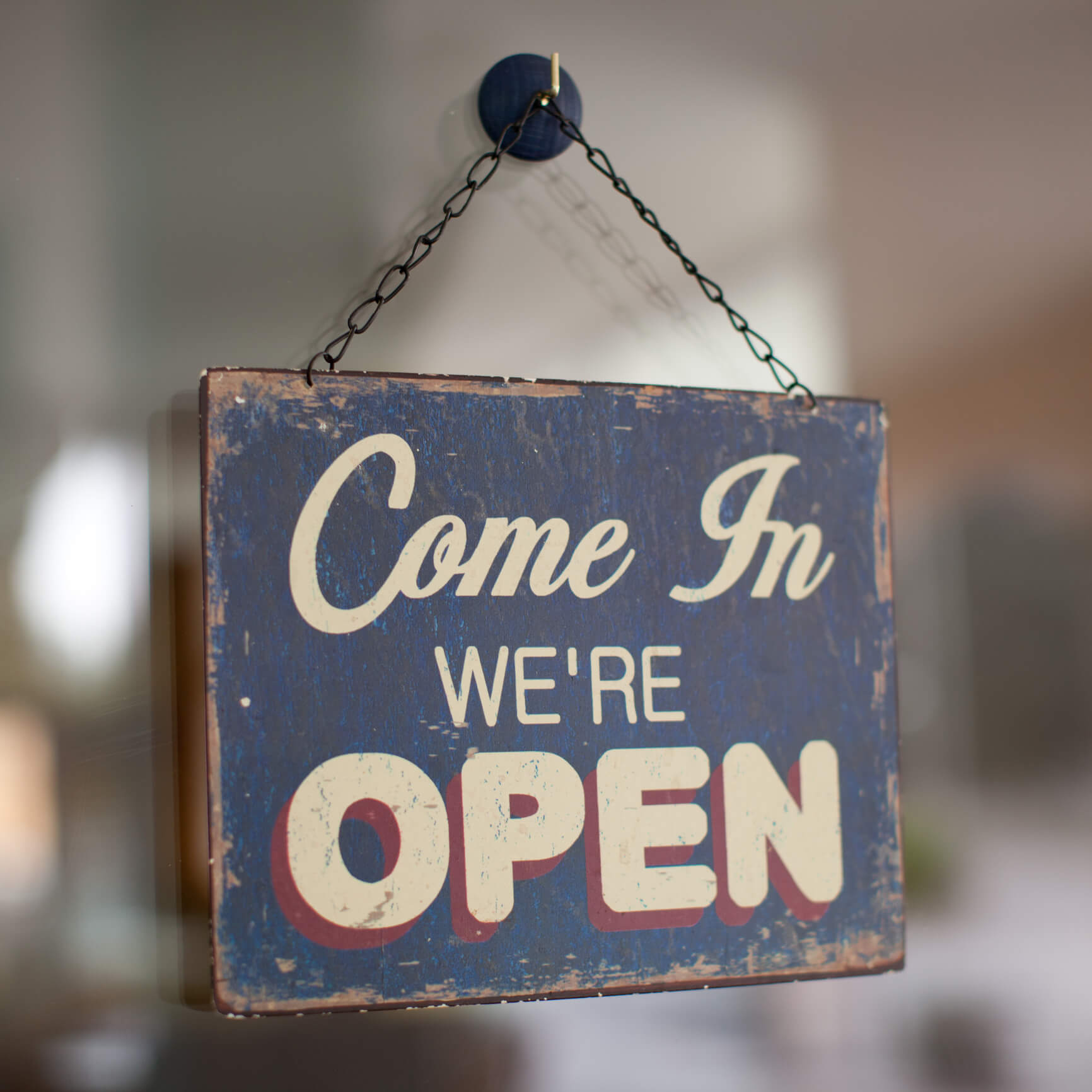 We're Open hanging sign