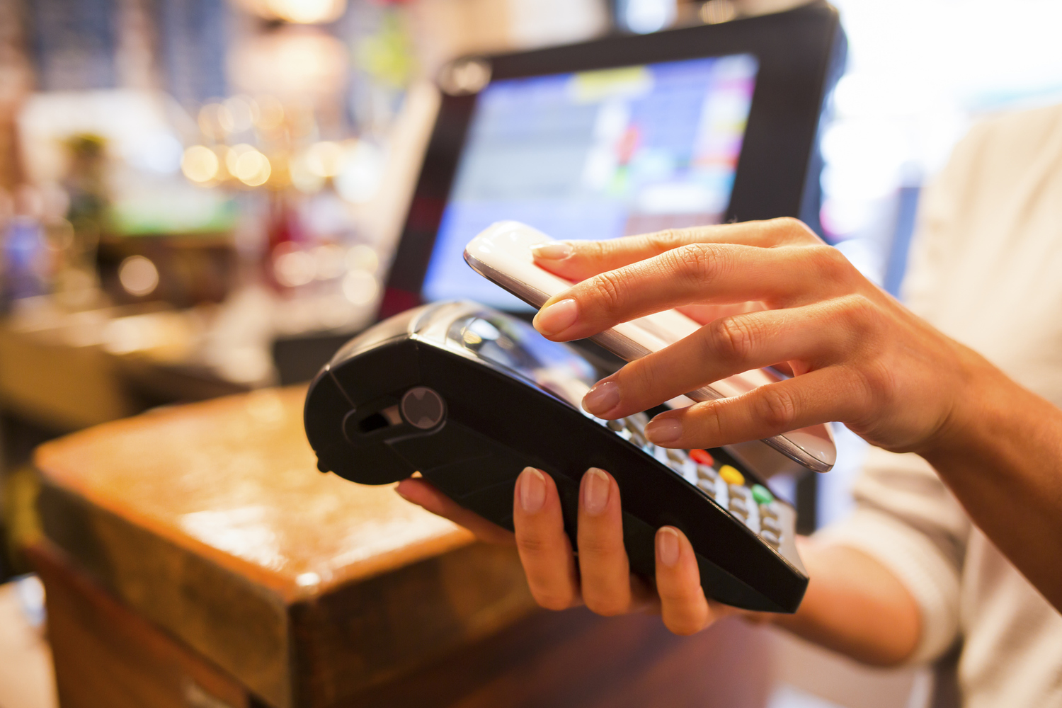 Holding phone over credit card reader