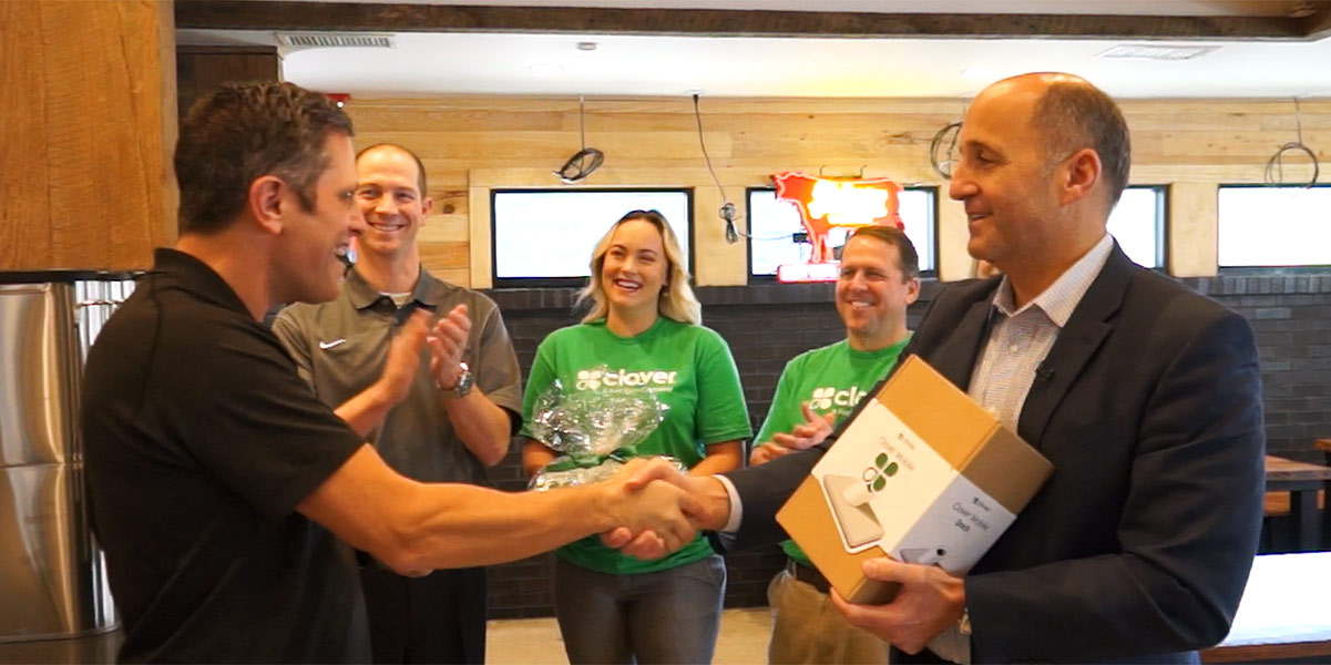 Shaking hands with Clover POS owner