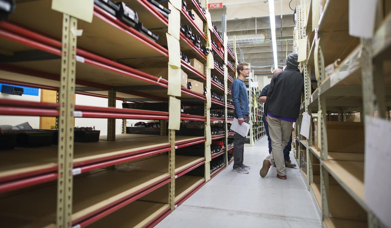 Employees standing between racks