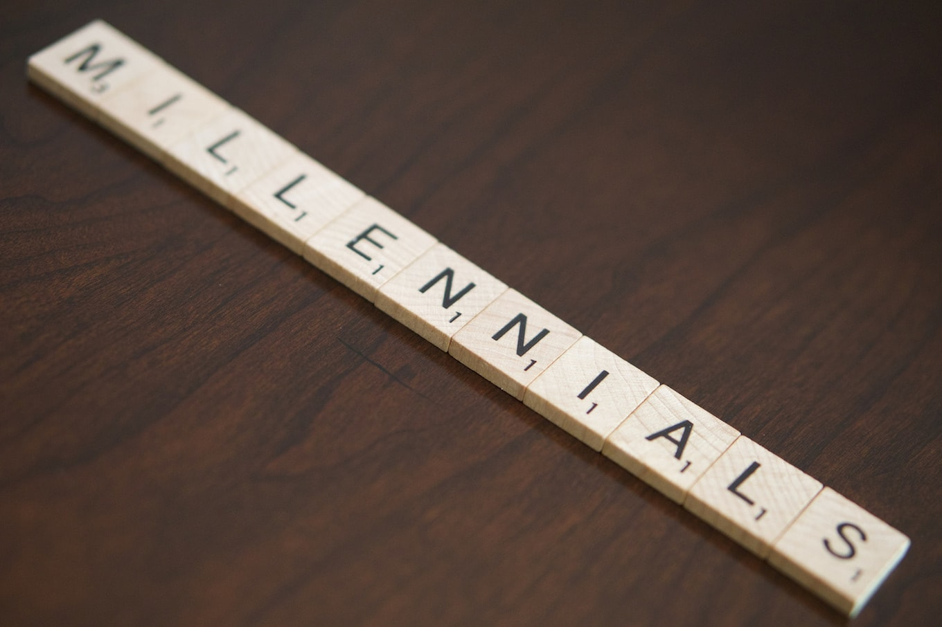 Millennials spelled in Scrabble tiles