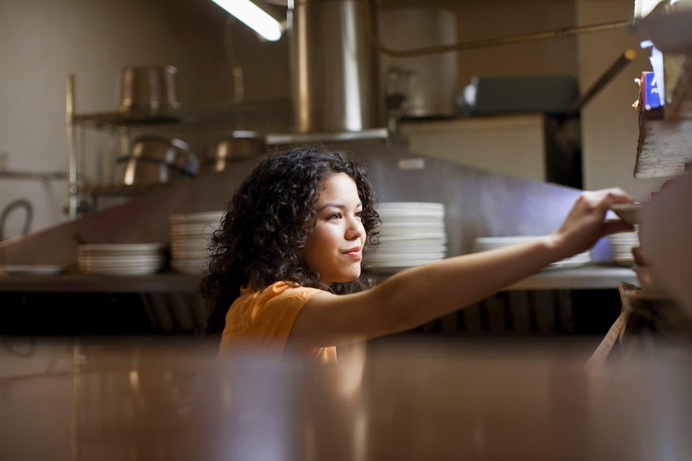 Restaurant server taking dish