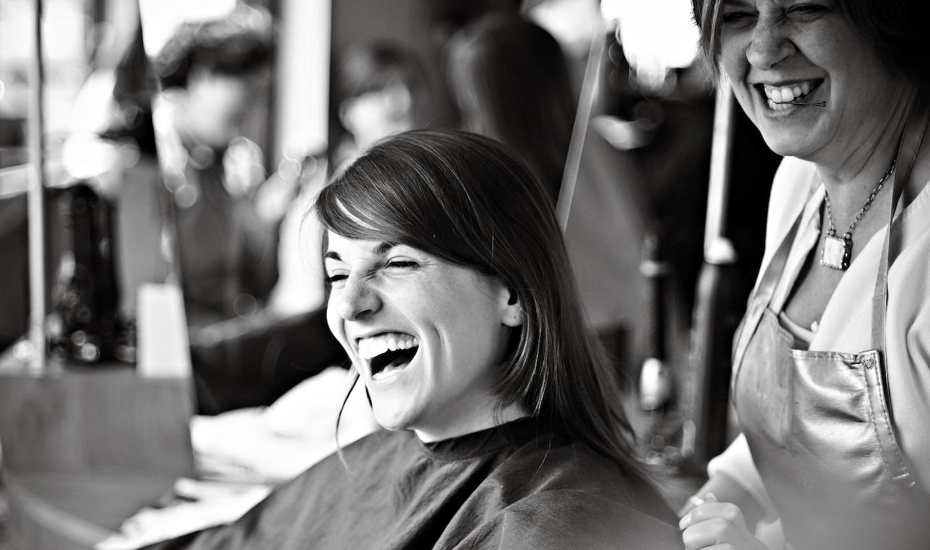 Smiling woman in salon chair