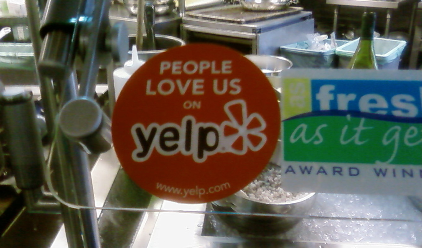 Yelp decal in business window