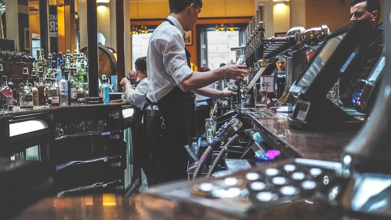 Bartenders serving drinks