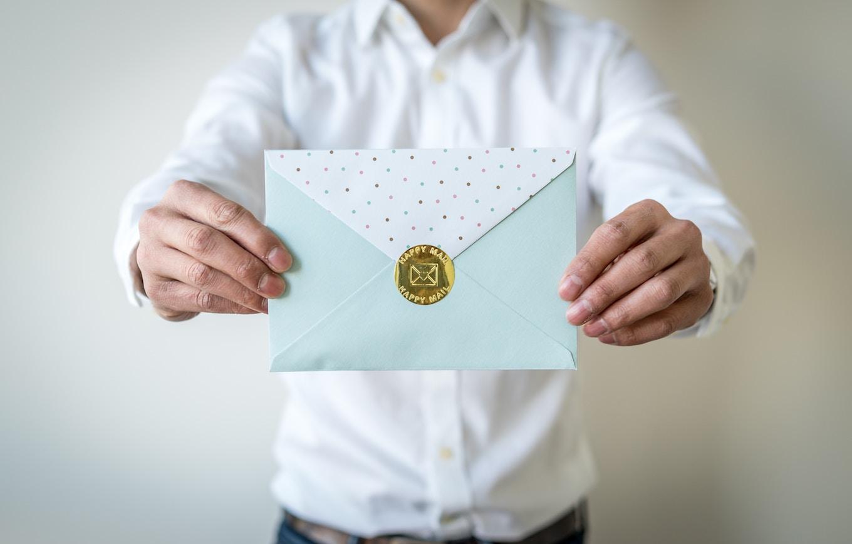Man holding sealed envelope