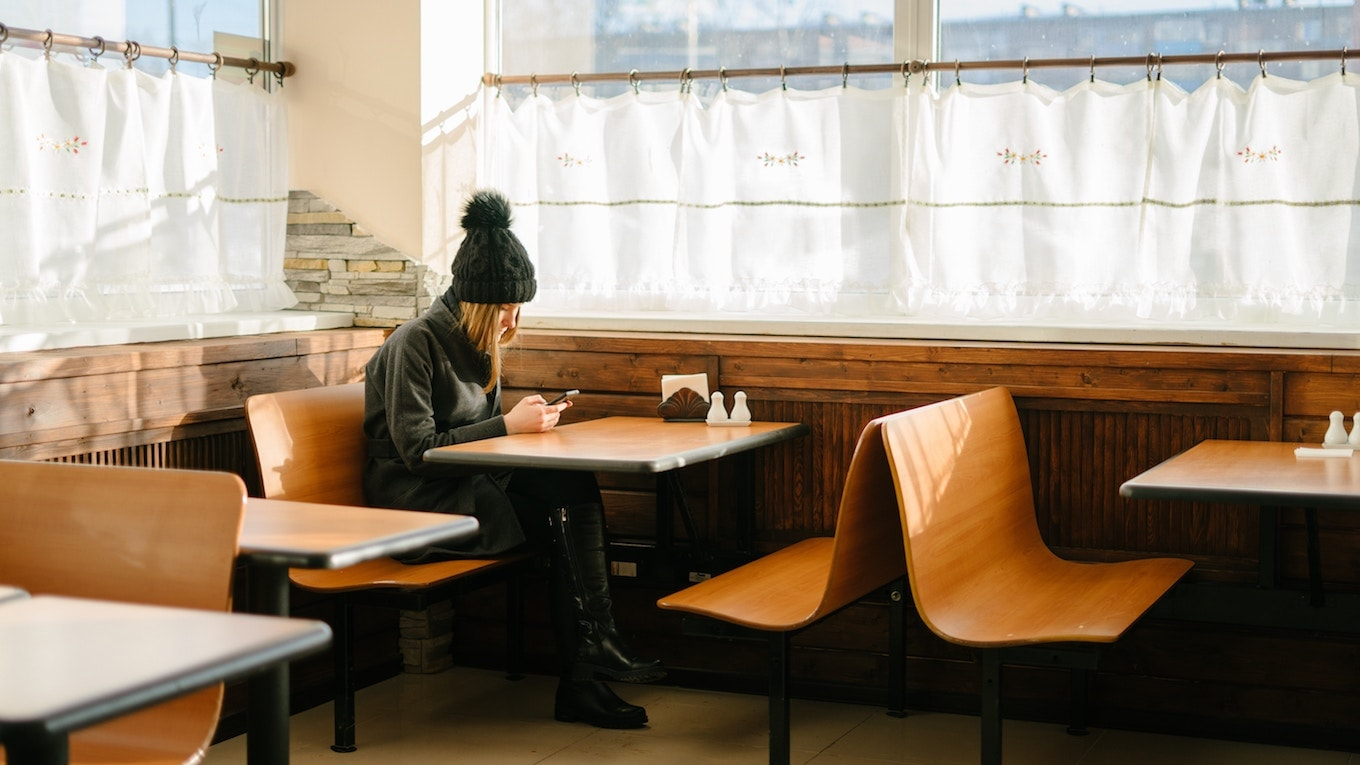 Woman sitting in restaurant booth