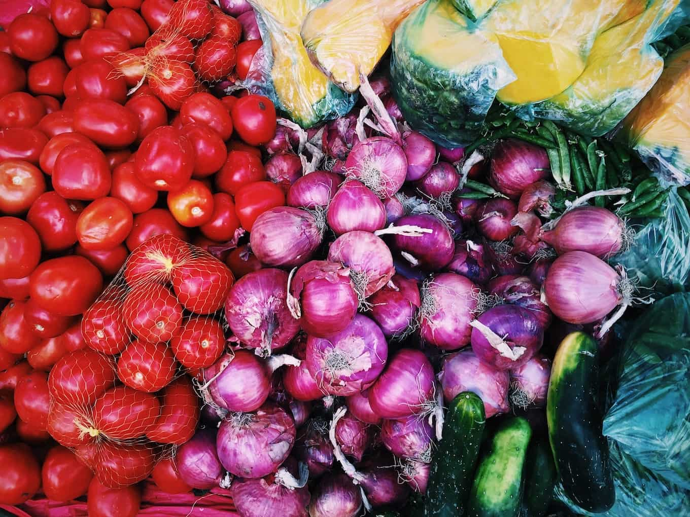 Group of tomatoes and vegetables