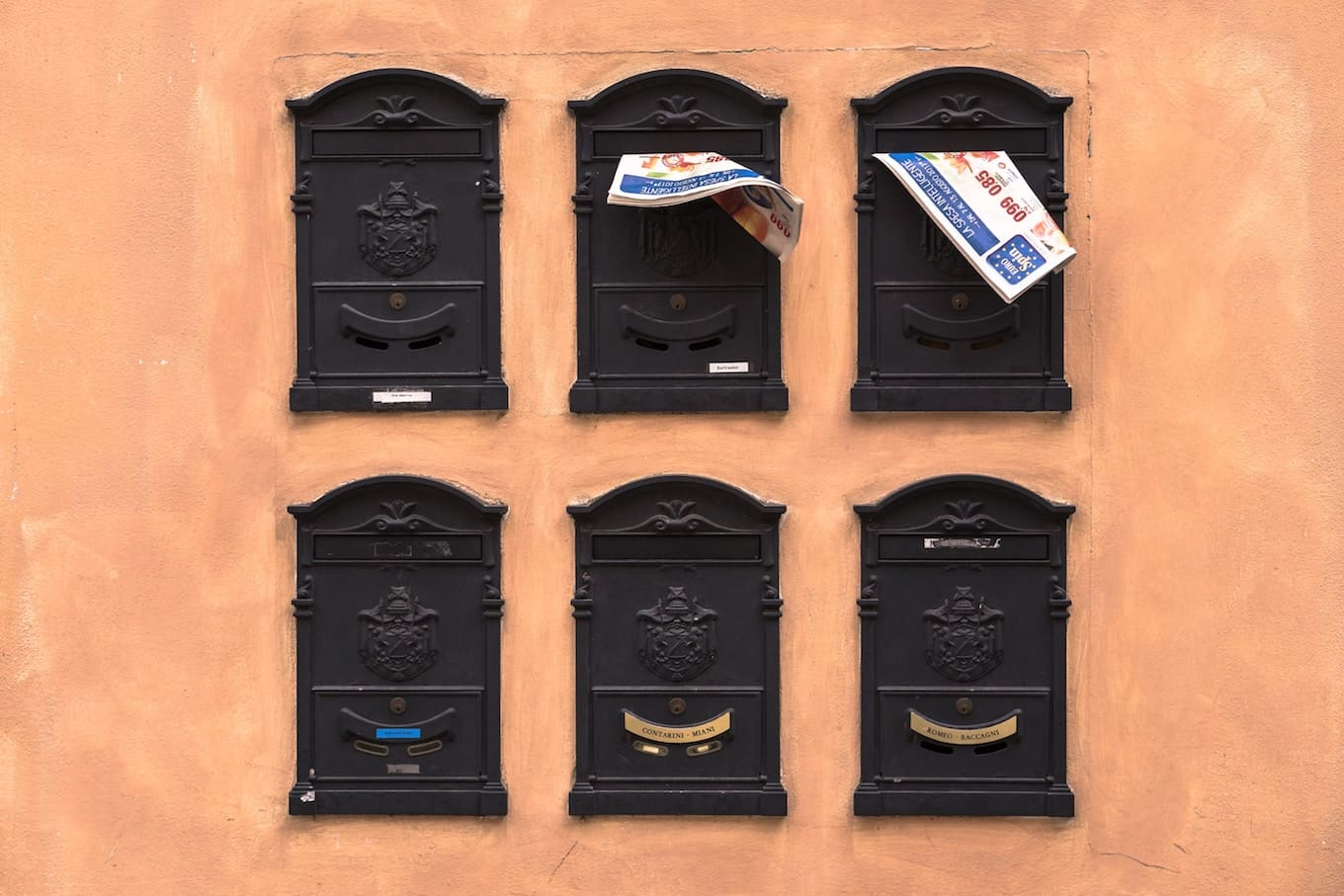 Six mailboxes on a wall
