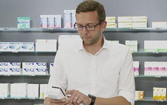 Man at pharmacy counter