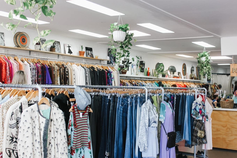 Racks of clothes inside a shop