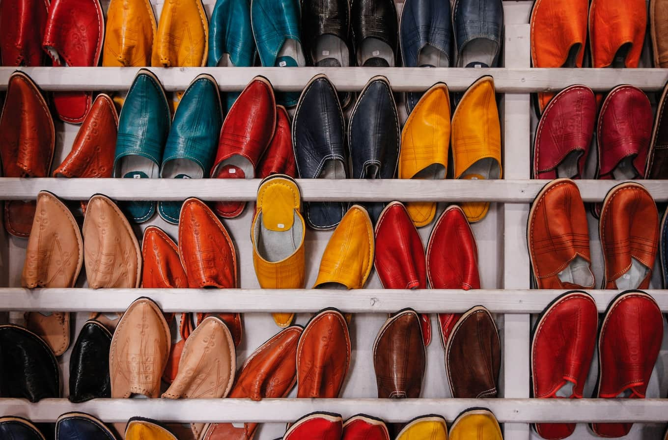 Racks of multi-colored shoes