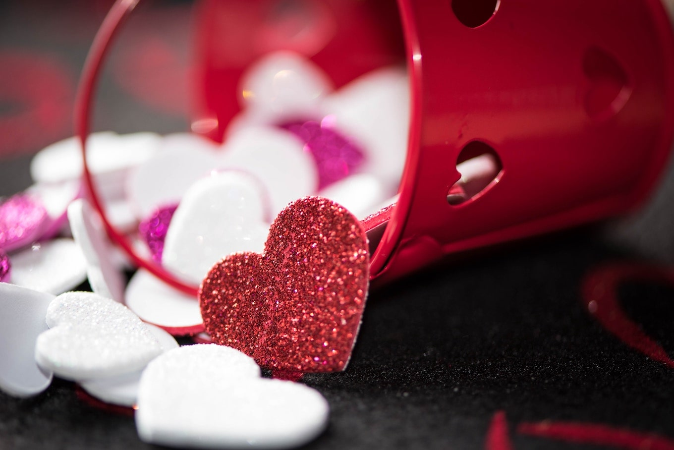Glitter hearts spilling out of bucket