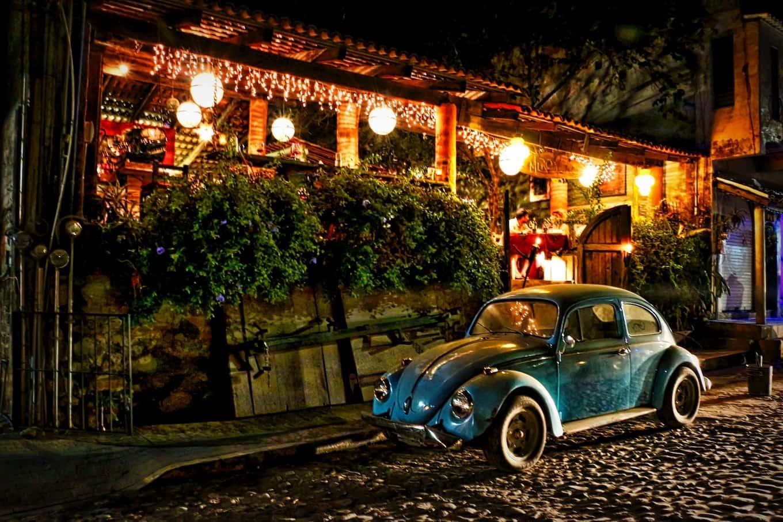 Volkswagen Beetle in front of restaurant