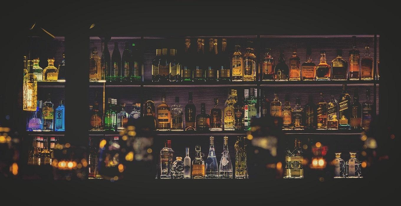 Shelves with liquor bottles
