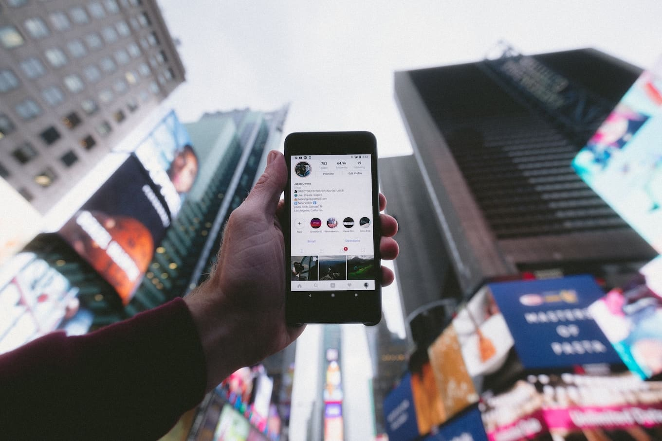 Holding phone in Times Square