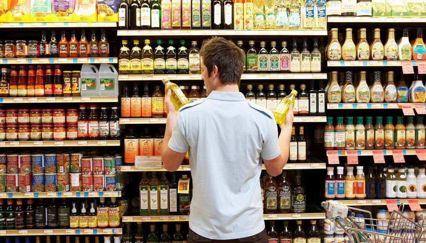Man deciding between oils
