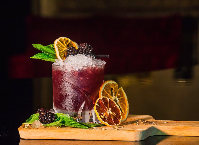 Purple cocktail with orange slices
