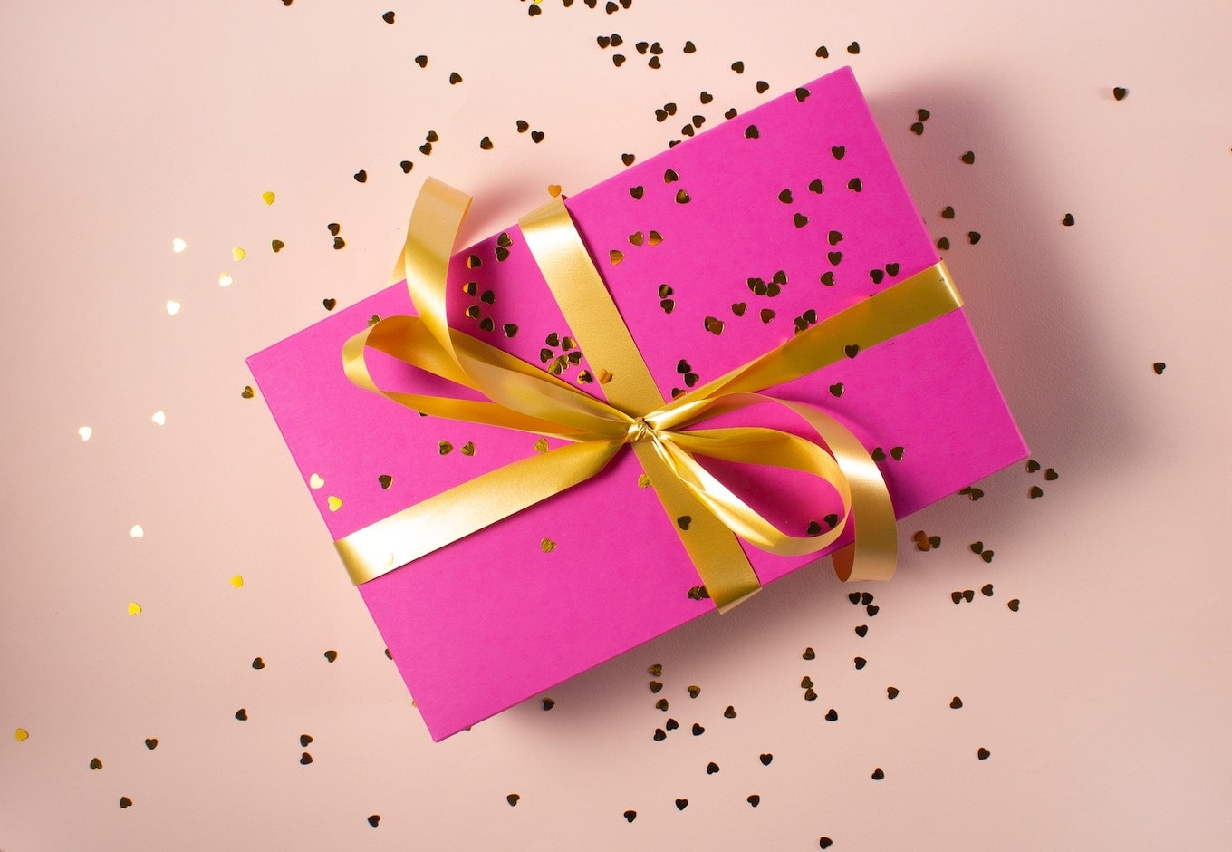 Pink gift box with gold ribbon