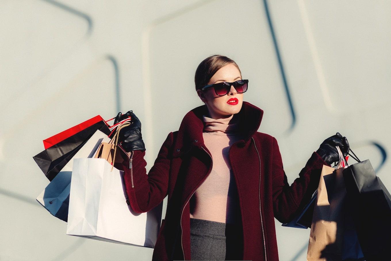 Stylish woman holding shopping bags
