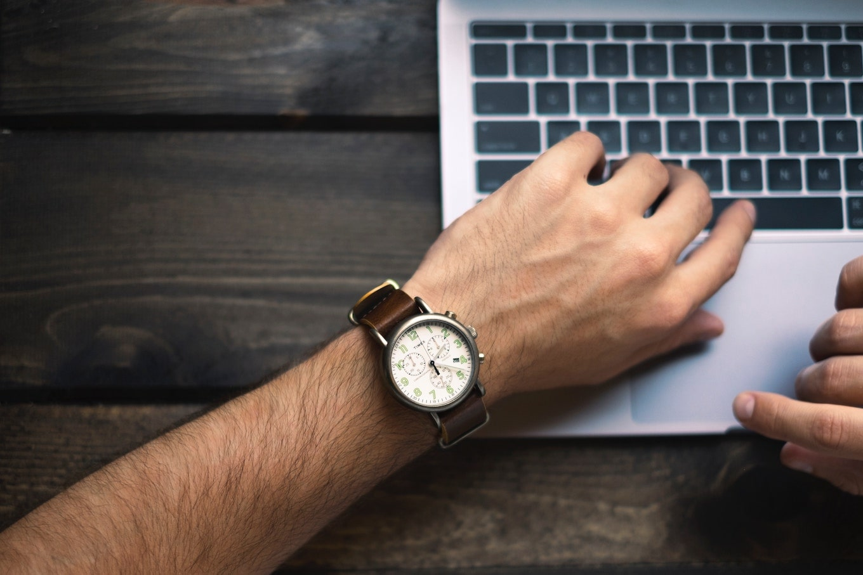 Watch on wrist on keyboard