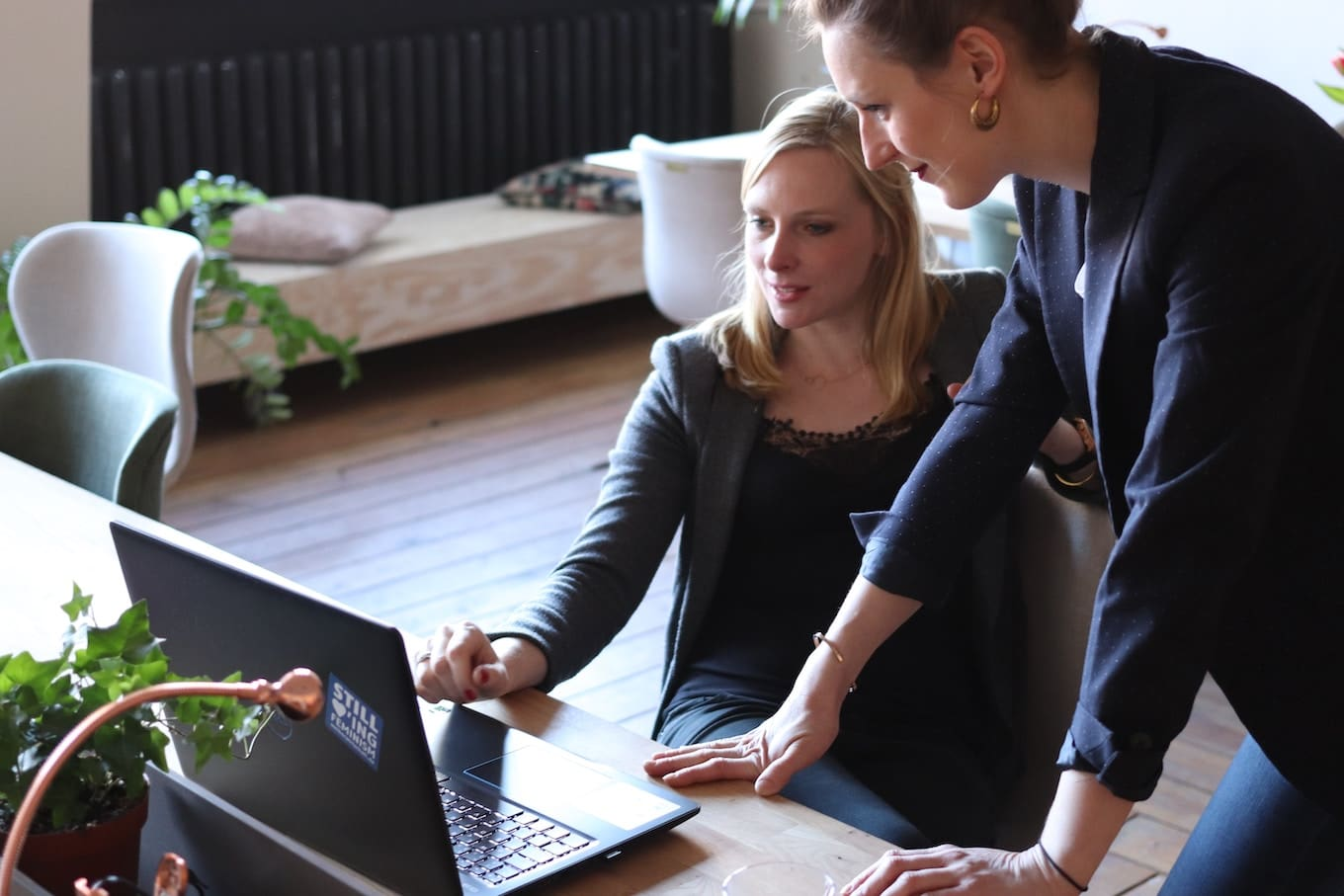Two women looking at laptop