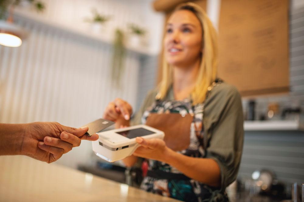 Woman with wireless credit card machine
