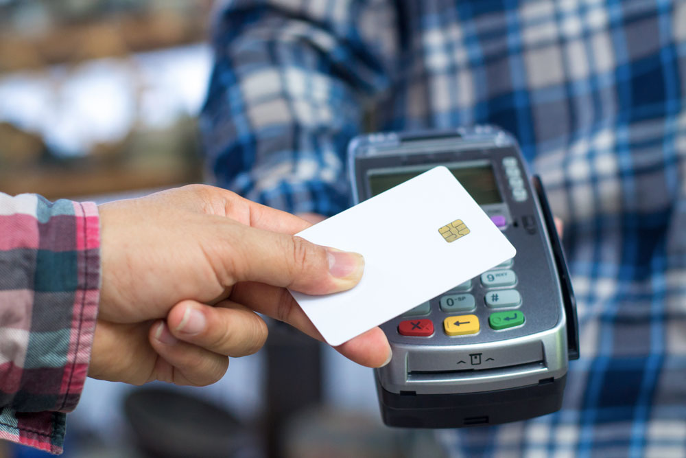 Contactless card over credit card reader