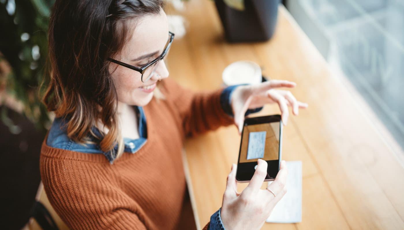 Woman making mobile deposit