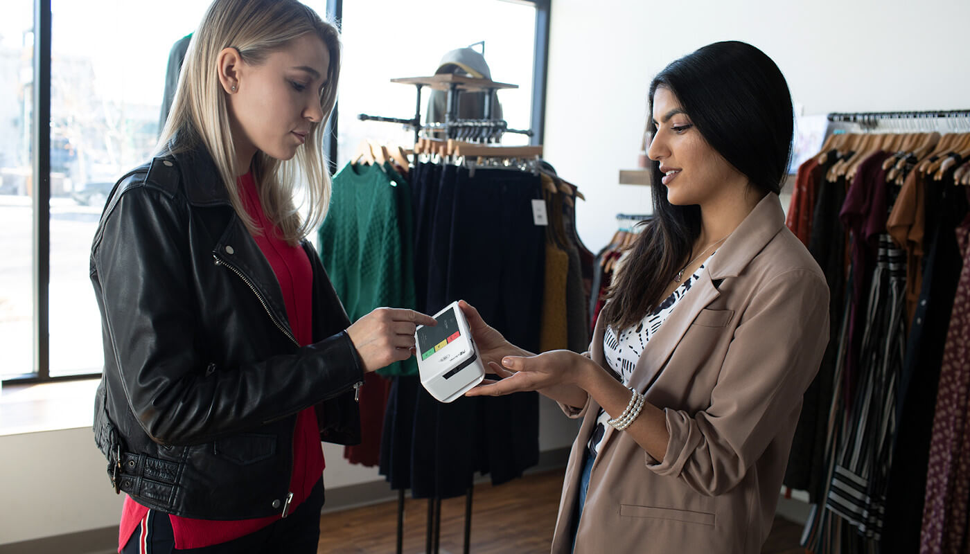 Woman making purchase in boutique