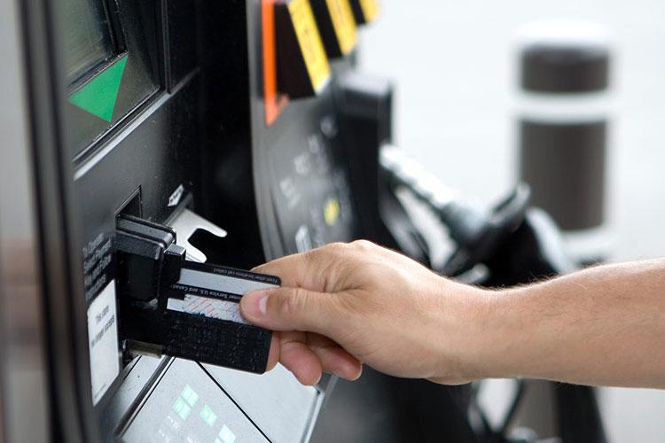 Inserting credit card at gas pump