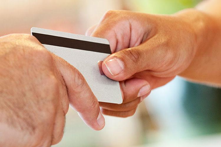 Hands exchanging credit card