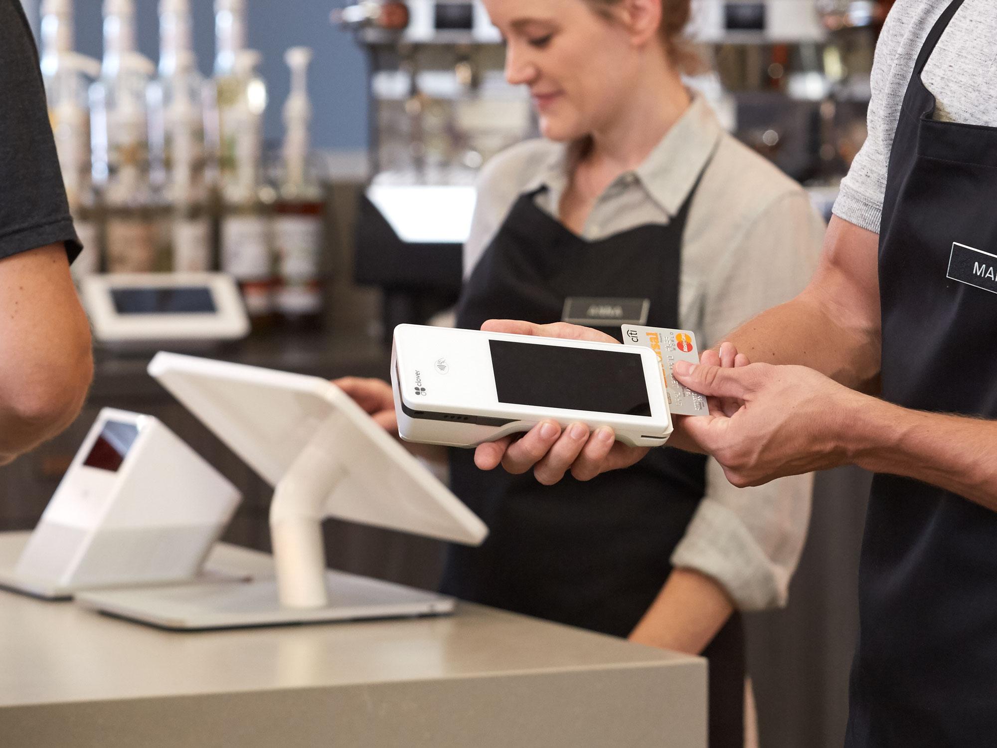 Swiping a credit card on Clover Flex