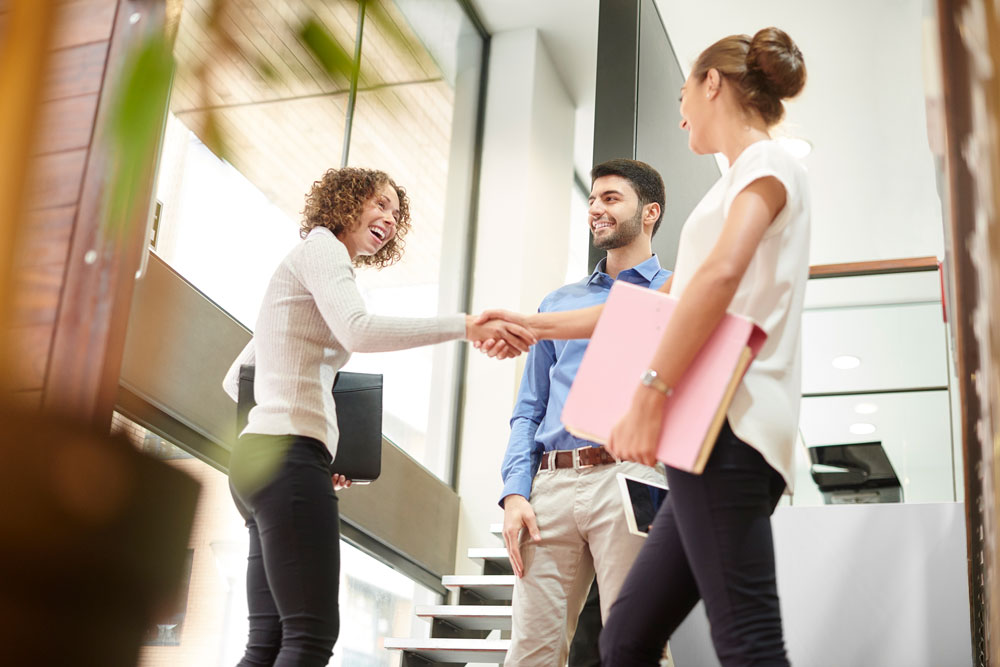 Three people shaking hands