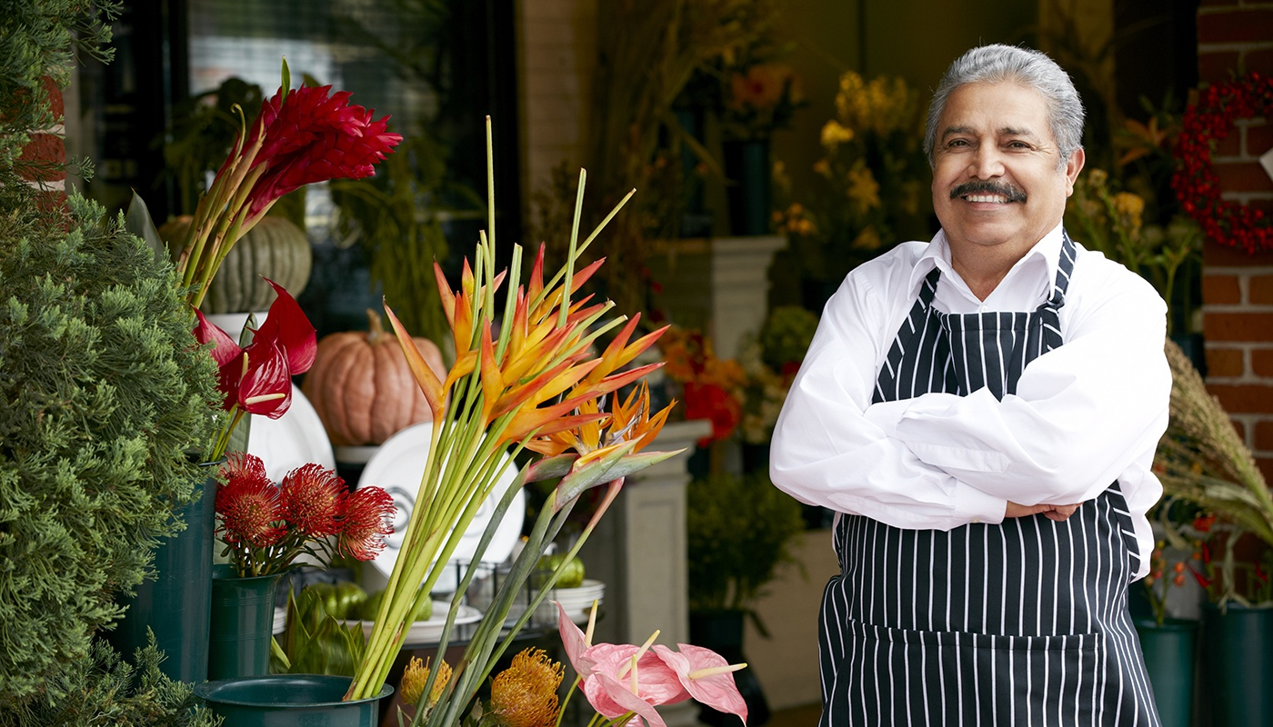 Hispanic business owner with his flowers