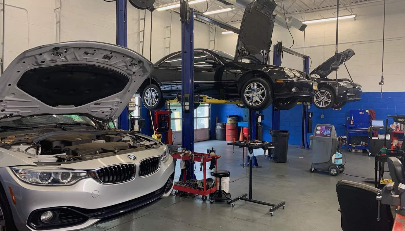 Luxury vehicles being serviced at Drummer Imports