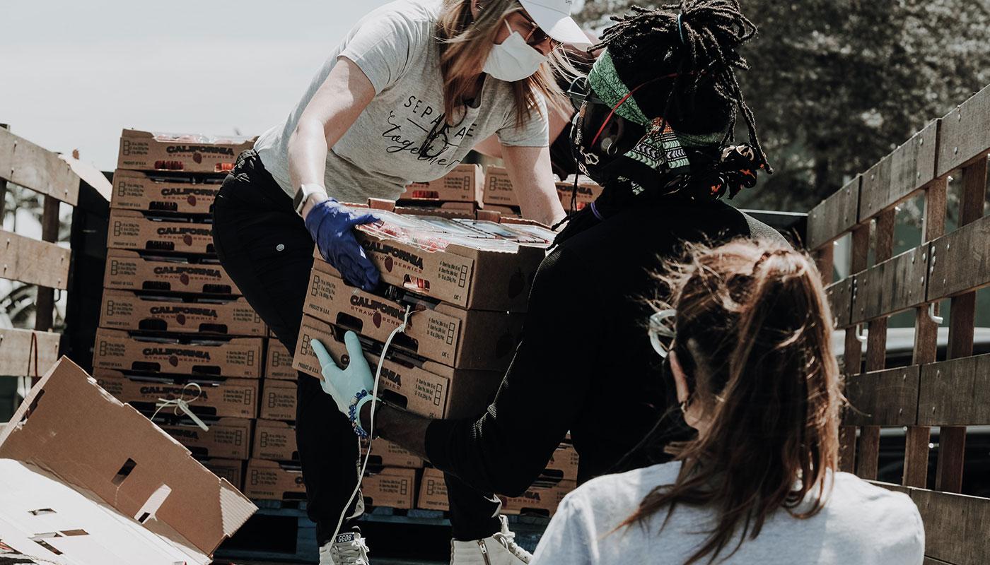 Team of people unloading produce