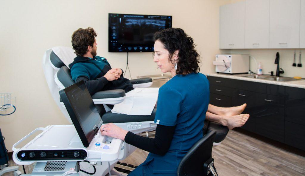 Dr. Jordanna Quinn working with a patient