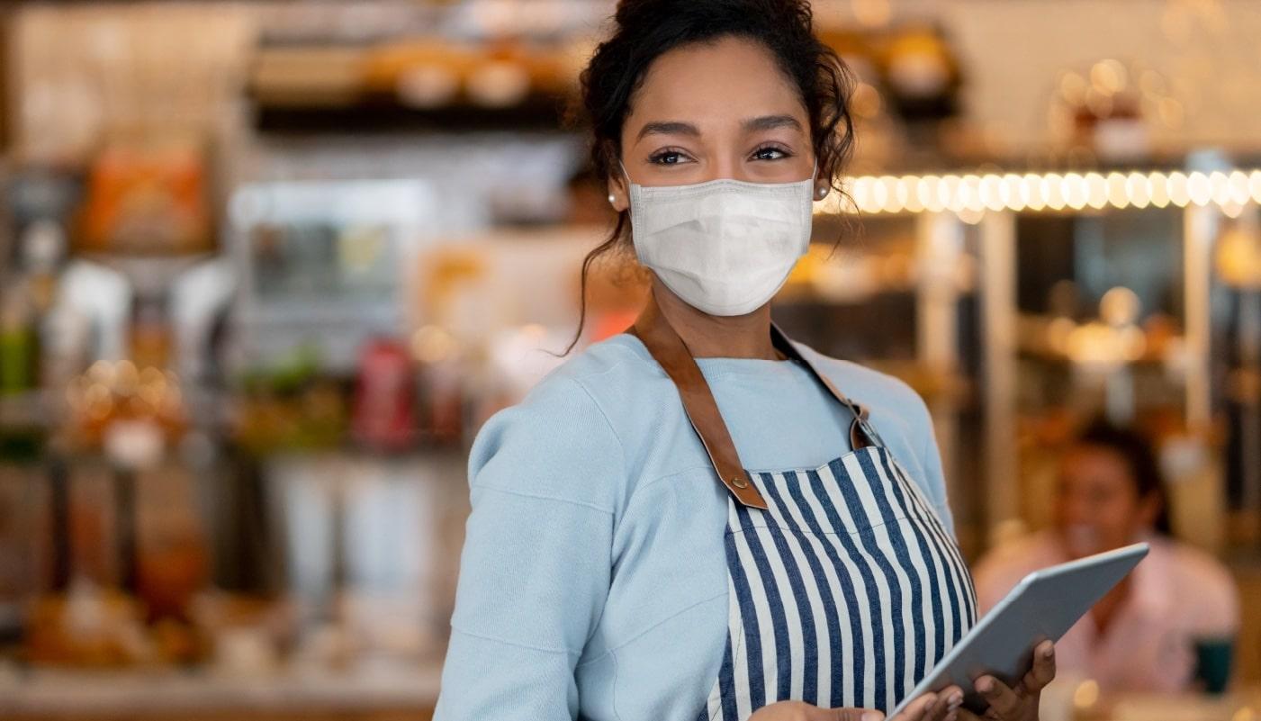 masked server in a restaurant