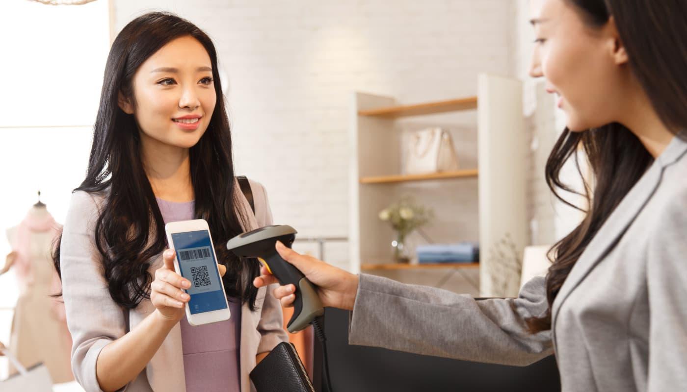 Cashier scanning eGift card on mobile