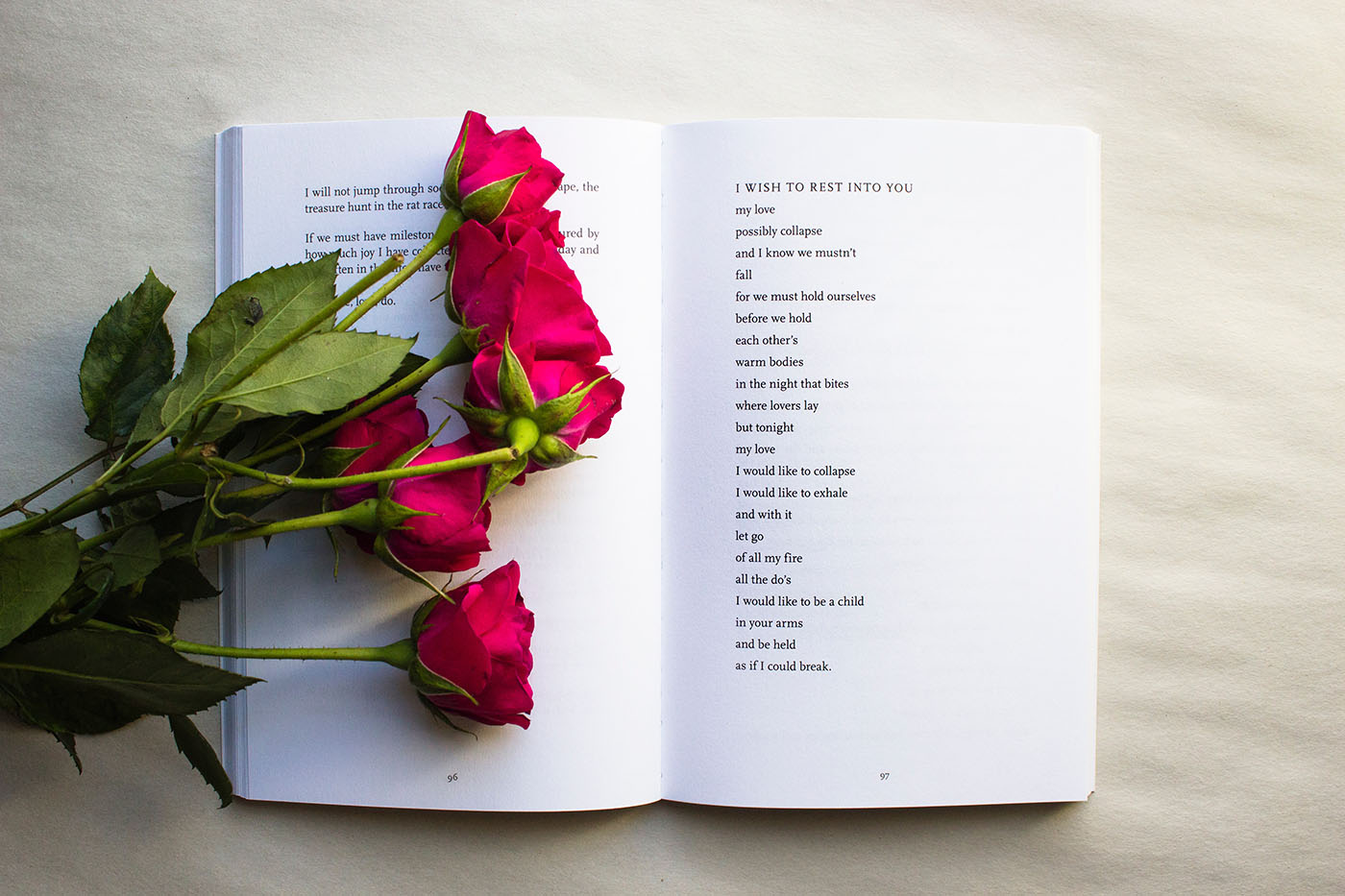 Roses laying on open poetry book