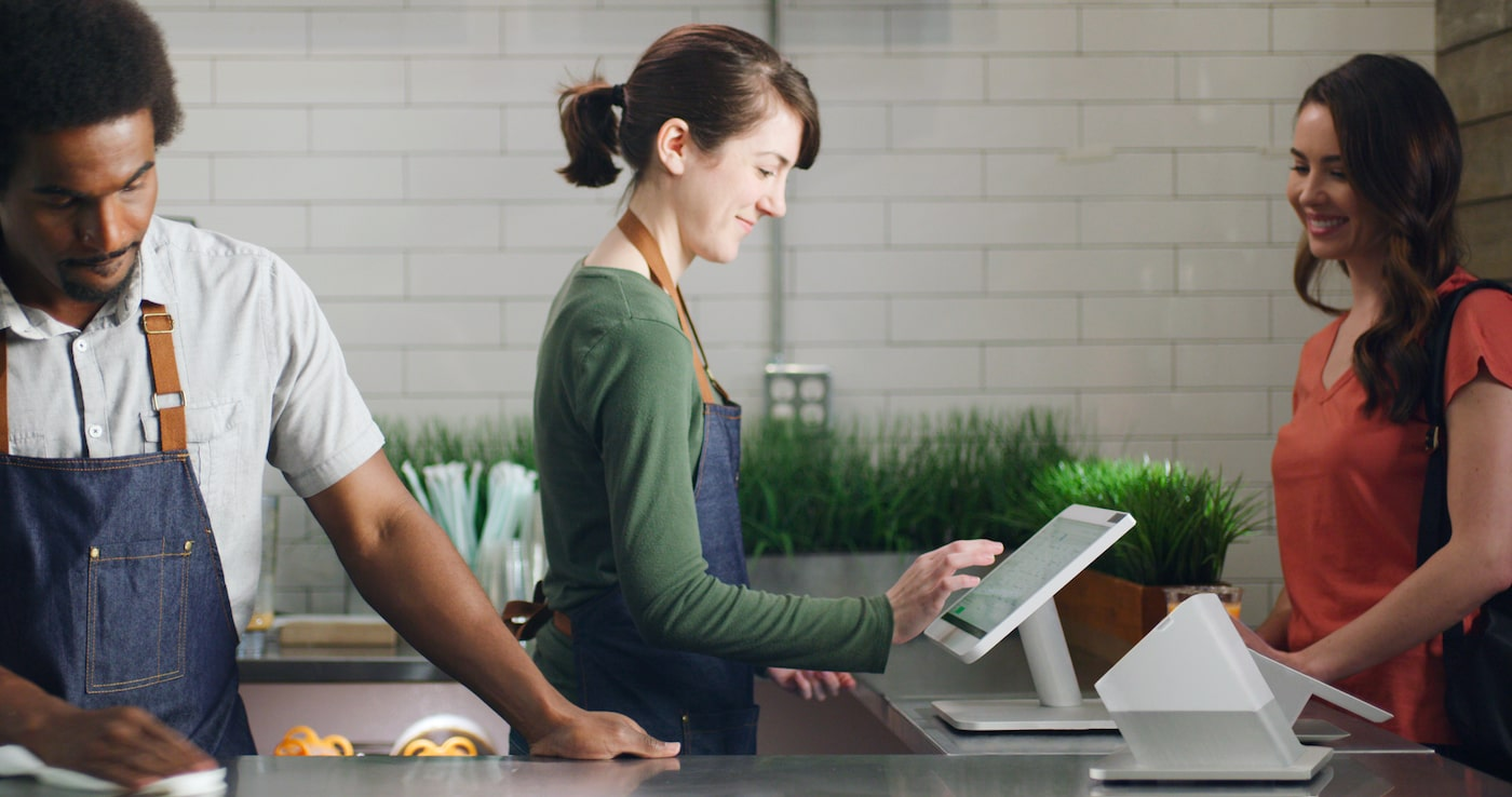 Woman using Clover Station POS