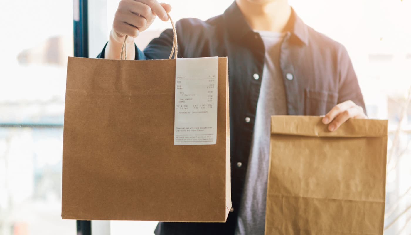 Man holding takeout bags