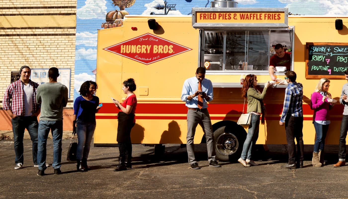 People standing in front of food truck