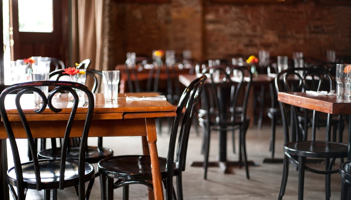 Tables and chairs in empty restaurant