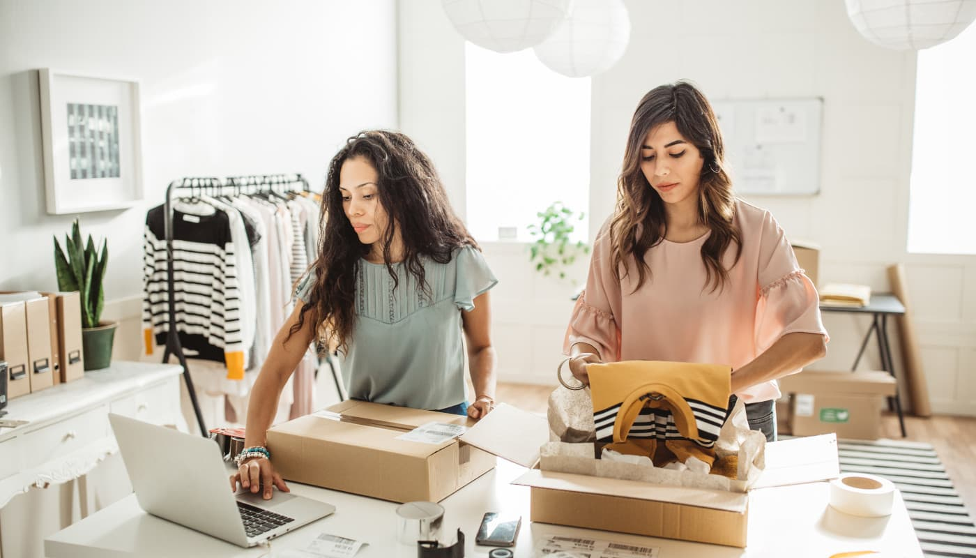Two women packing online orders