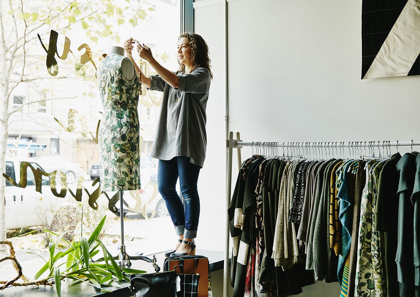 Female business owner dressing dress form