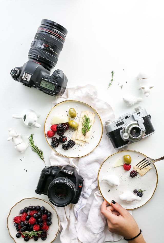 Cameras and plates of food
